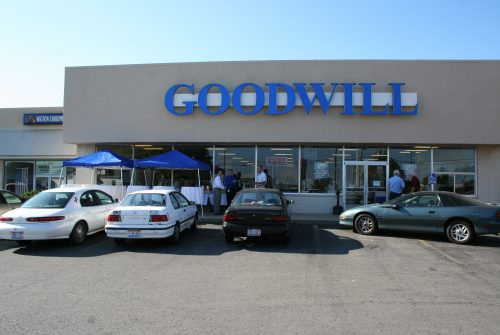 Goodwill store exterior, one-story brick and stucco building in shopping center