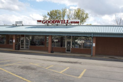 Goodwill store exterior, located in a shopping center, one-story brick building