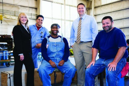 Diverse group of men and women in business suits or work overalls