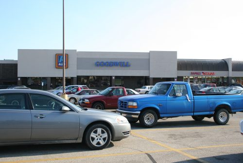 Goodwill store exterior, one-story brick and stucco building in a shopping center.