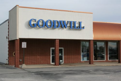 Goodwill store exterior, one-story brick and stucco building in a shopping center