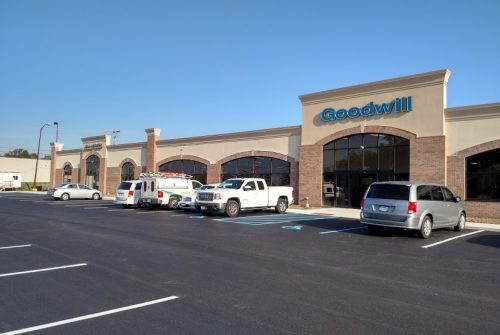Goodwill store exterior, one-story brick and stucco building.